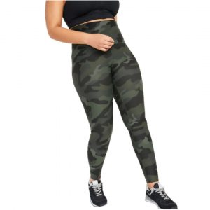 Plus size mom in waisted in compression postpartum leggings